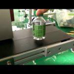 stolní etiketovací stroj na plastové lahve s vodou