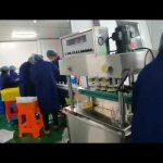 rotační plnící a uzavírací stroj